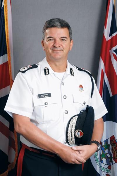 Mr. David Baines OBE, Commissioner of Police